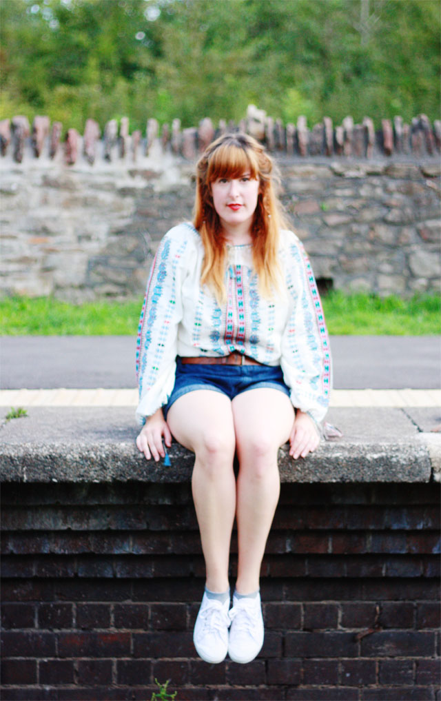 White embroidered blouse and denim shorts