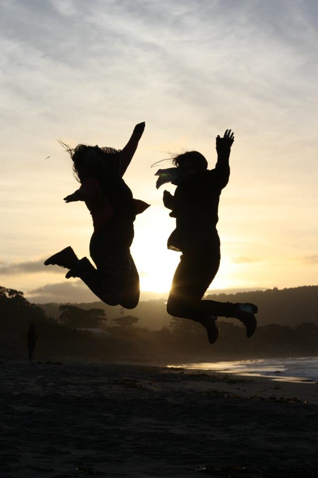 Jumping on Monterey beach