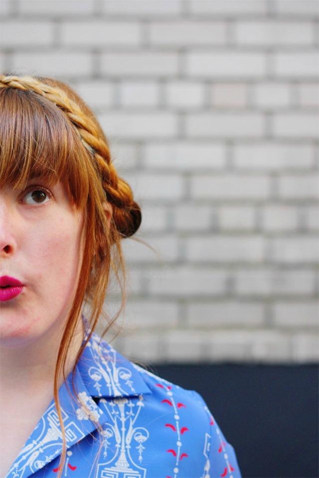 Milkmaid braids and a bold lip