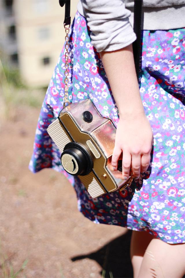 Accessorize gold camera bag