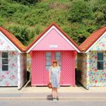 Posing by the Cath Kidston beach huts