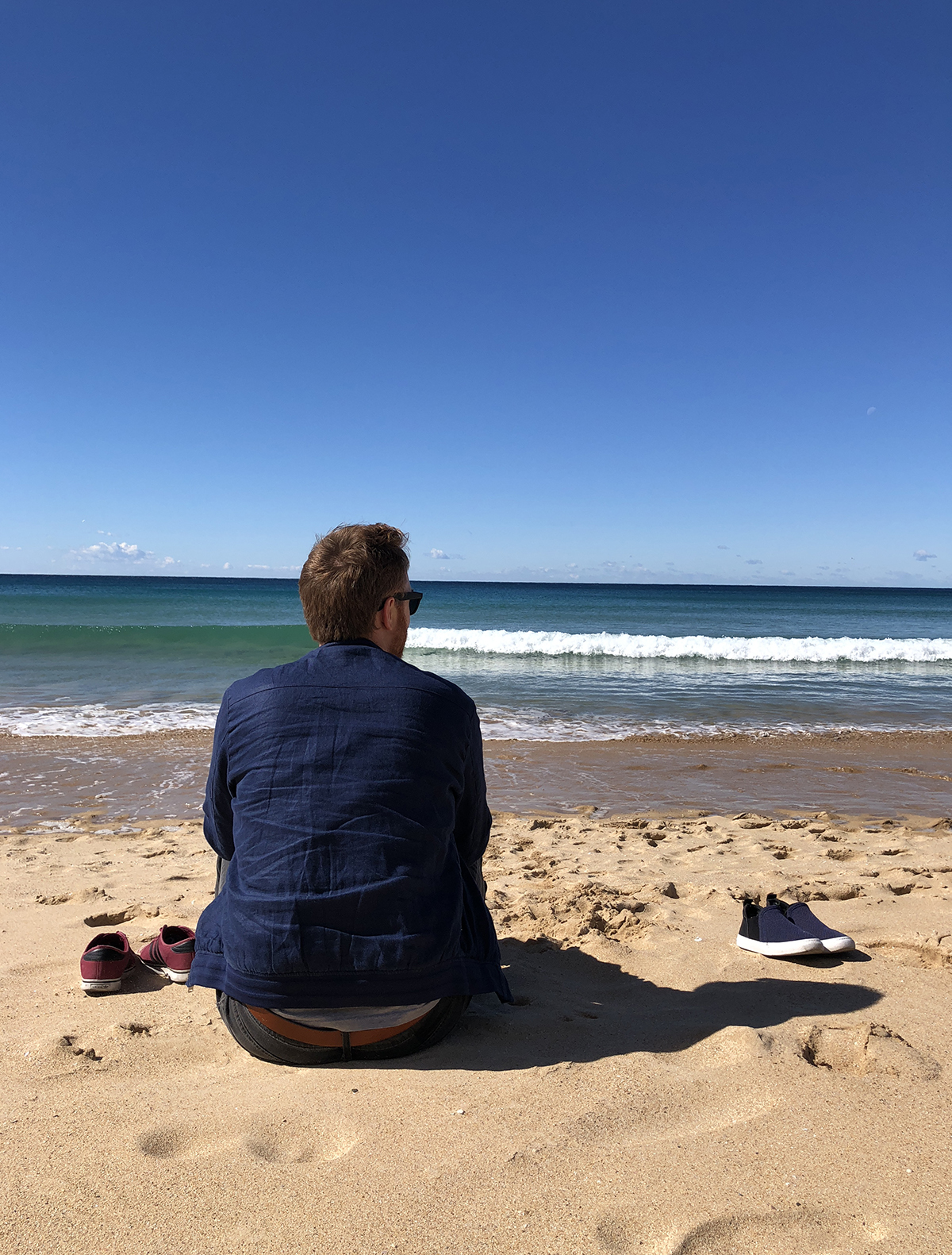 M looking out to sea at Manly